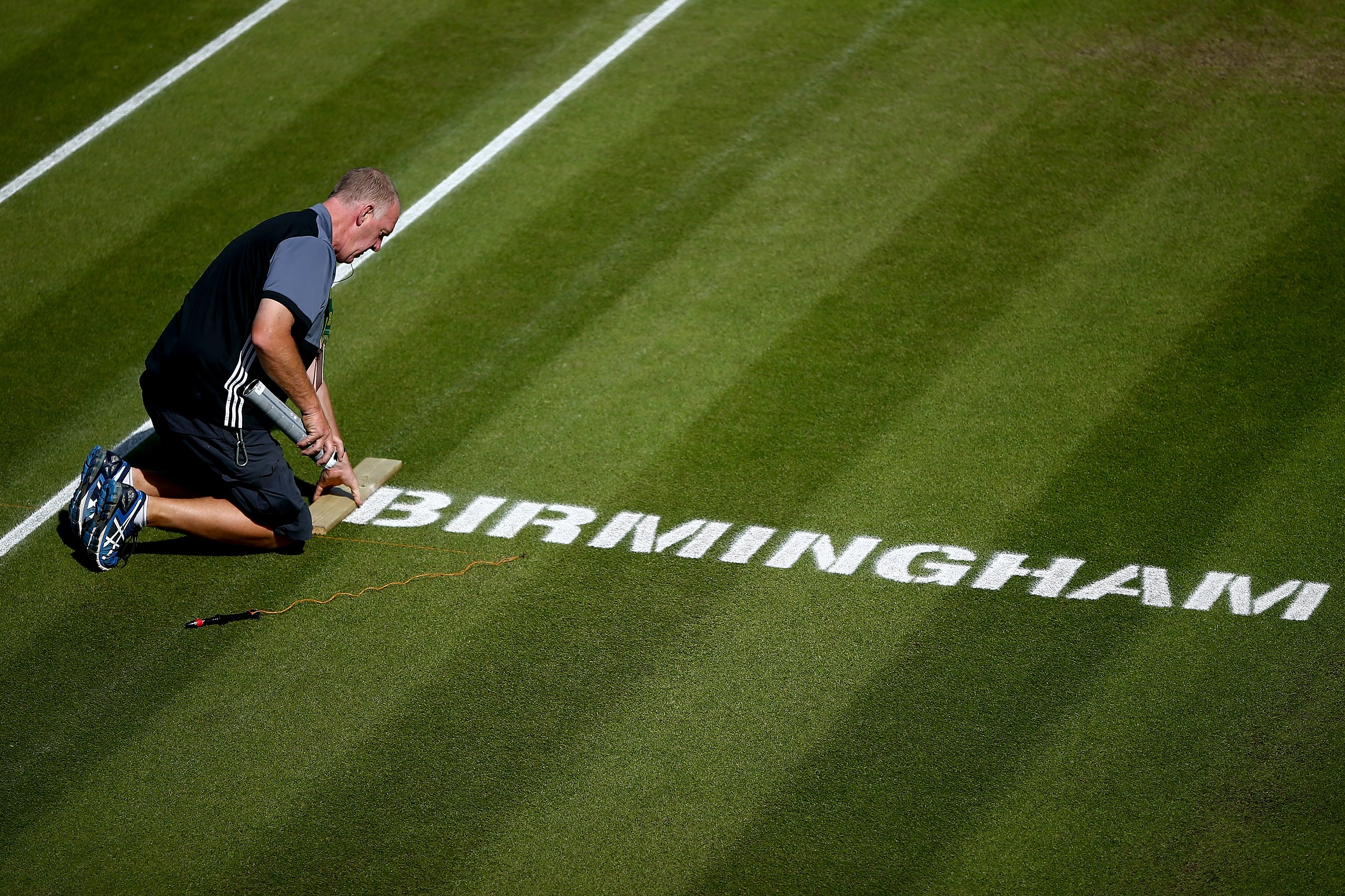 Groundstaff prepare the courts ahead of the start of play on Day Nine