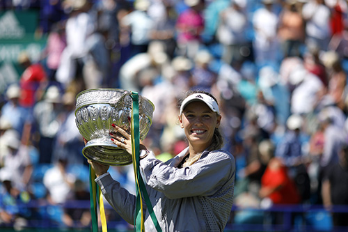 Caroline Wozniacki holds the singles trophy for the Nature Valley International