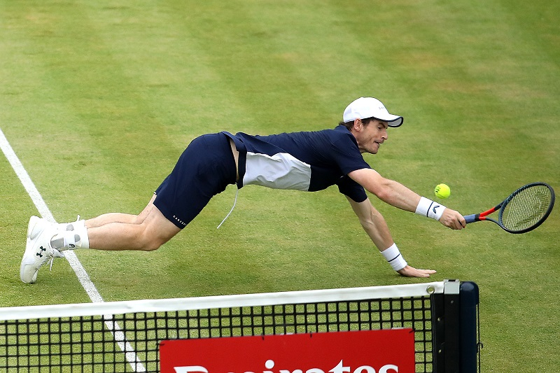 Andy Murray dives to return the ball in the mens doubles final