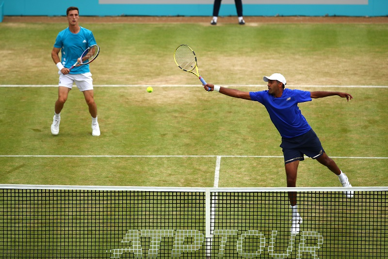 Rajeev Ram returns the ball during the mens doubles final