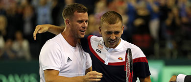 GLASGOW, SCOTLAND - SEPTEMBER 14: Leon Smith, captain of Team Great Britain and Dan Evans celebrates after the match against Denis Istomin of Uzbekistan (not pictured) during day one of the Davis Cup by BNP Paribas World Group single's play-off between Great Britain and Uzbekistan at Emirates Arena on September 14, 2018 in Glasgow, Scotland. (Photo by Ian MacNicol/Getty Images for LTA)